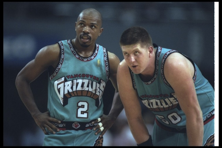 Greg Anthony and Bryant Reeves talk during a game in 1997