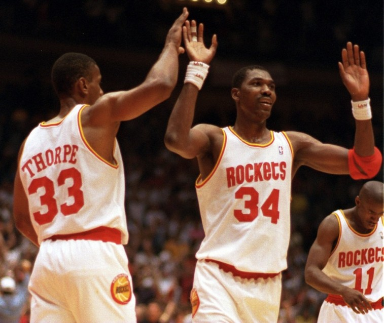 The Rockets give high fives.