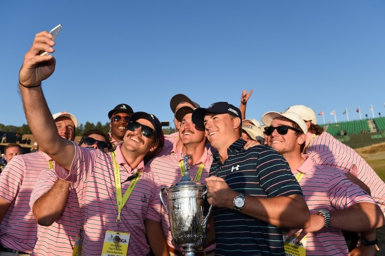 Jordan Spieth takes a picture with workers after winning the 2015 U.S. Open