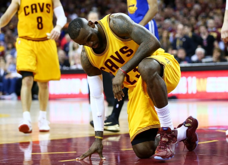 LeBron James gets up after falling in Game 4