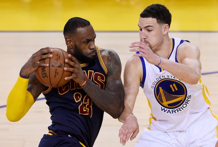 LeBron James drives on Klay Thompson in 2015 NBA Finals.