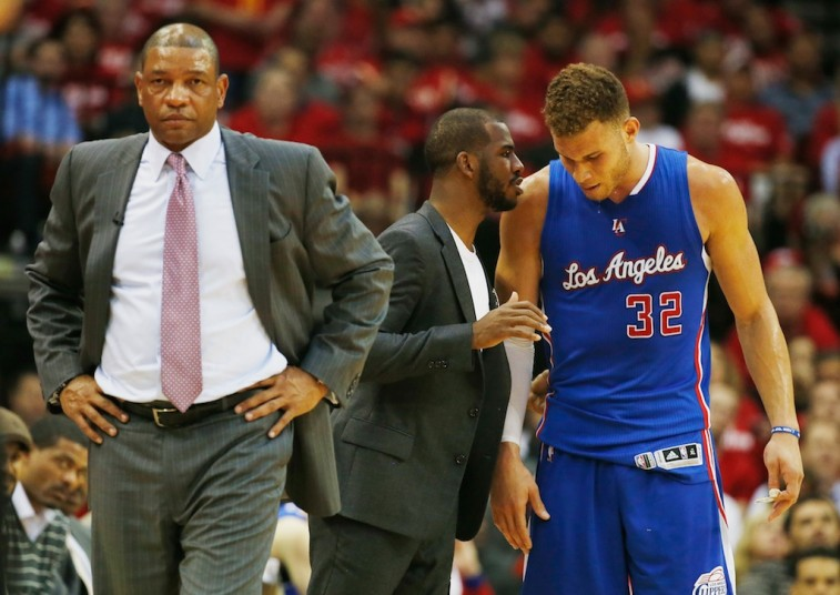 HOUSTON, TX - MAY 06: Head coach Doc Rivers of the Los Angeles Clippers waits alongside Chris Paul #3 and Blake Griffin #32 on the court in the second half against the Houston Rockets during Game Two in the Western Conference Semifinals of the 2015 NBA Playoffs on May 6, 2015 at the Toyota Center in Houston, Texas. NOTE TO USER: User expressly acknowledges and agrees that, by downloading and/or using this photograph, user is consenting to the terms and conditions of the Getty Images License Agreement. (Photo by Scott Halleran/Getty Images)
