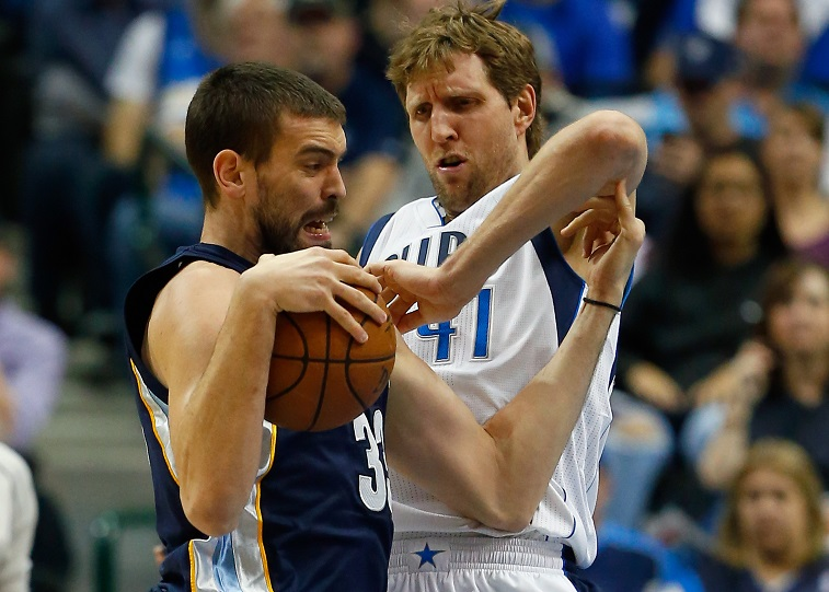 Gasol Drives by Dirk at American Airlines Center on January 27, 2015 in Dallas, Texas. NOTE TO USER: User expressly acknowledges and agrees that, by downloading and or using this photograph, User is consenting to the terms and conditions of the Getty Images License Agreement.