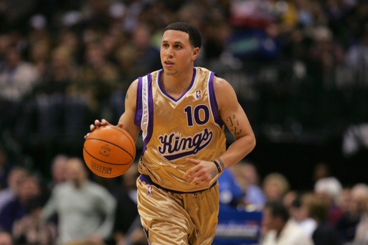 Mike Bibby brings the ball upcourt.