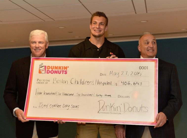 Rob Gronkowski presents check at the Boston Children's Hospital