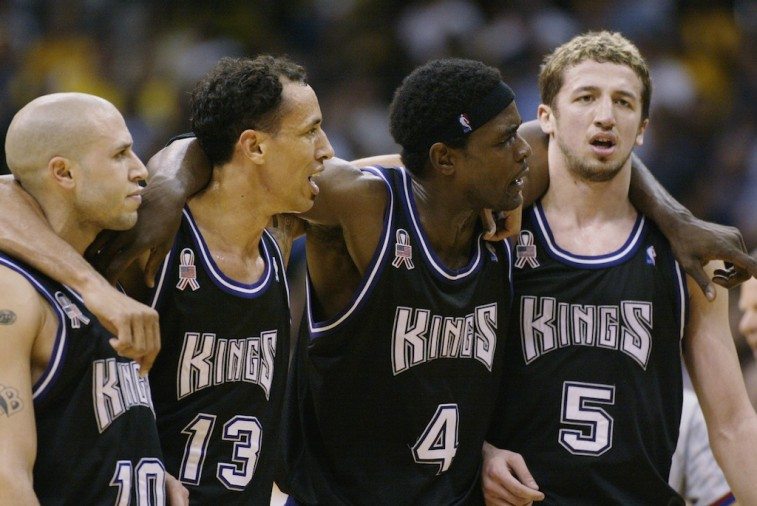 The Sacramento Kings put their arms around each others' shoulders.
