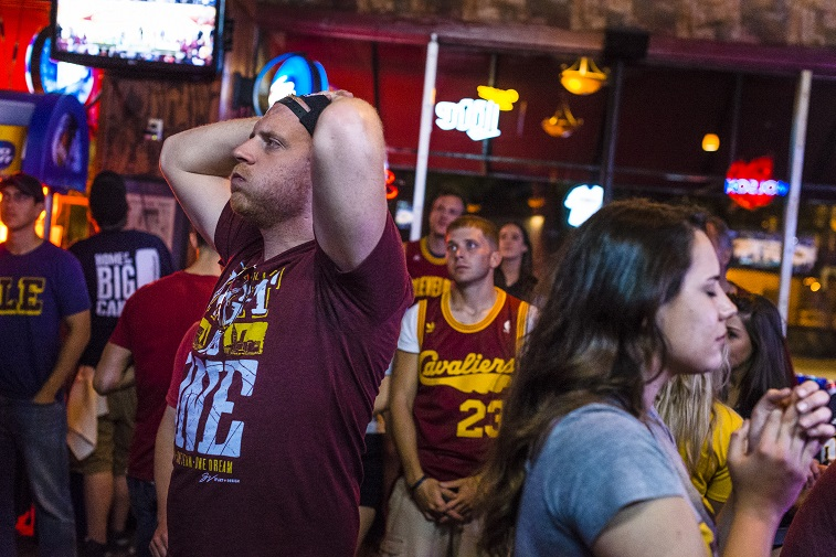CLEVELAND, OH- JUNE 16: Cleveland Cavaliers fans react during game 6 of the NBA finals on June 16, 2015 in Cleveland, Ohio. The Golden State Warriors defeated The Cleveland Cavaliers 105-97 to win their first championship since 1975.