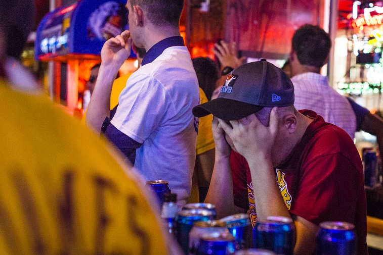 A Cleveland Cavaliers fan holds his head while watching the NBA Finals.