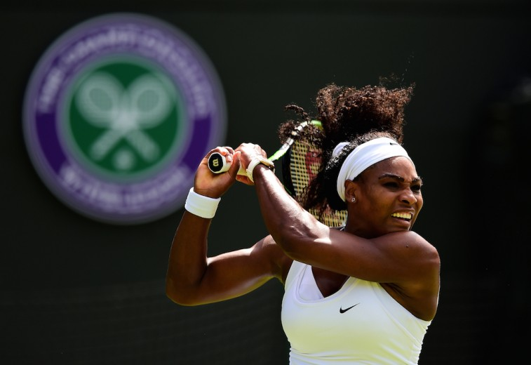 Serena Williams hits a backhand during first round of the 2015 Wimbledon