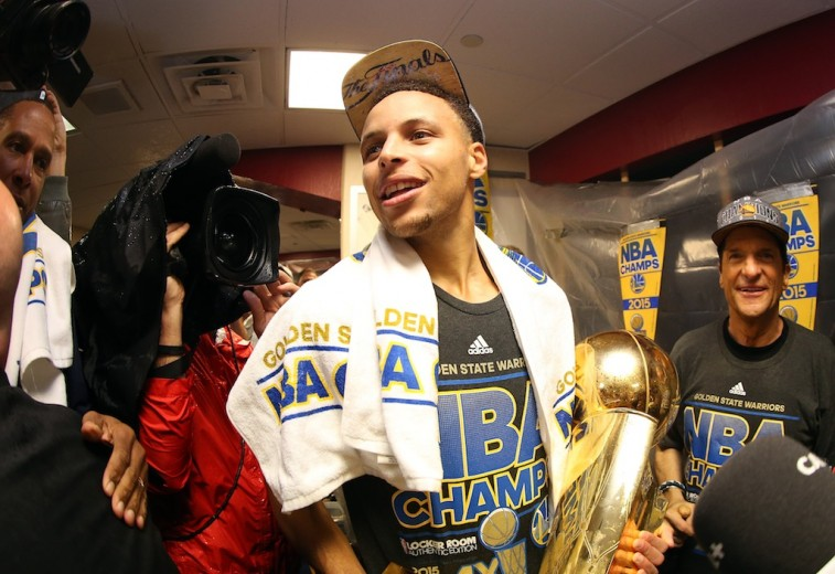 Stephen Curry with the Larry O'Brien Trophy