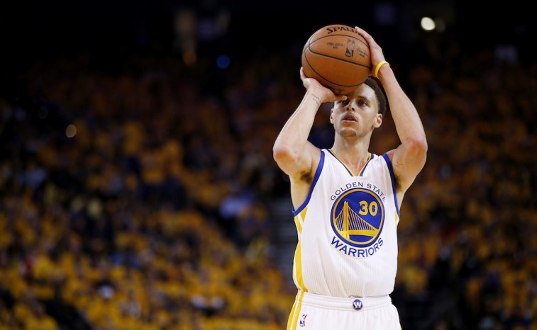 Stephen Curry prepares for a three-point shot.