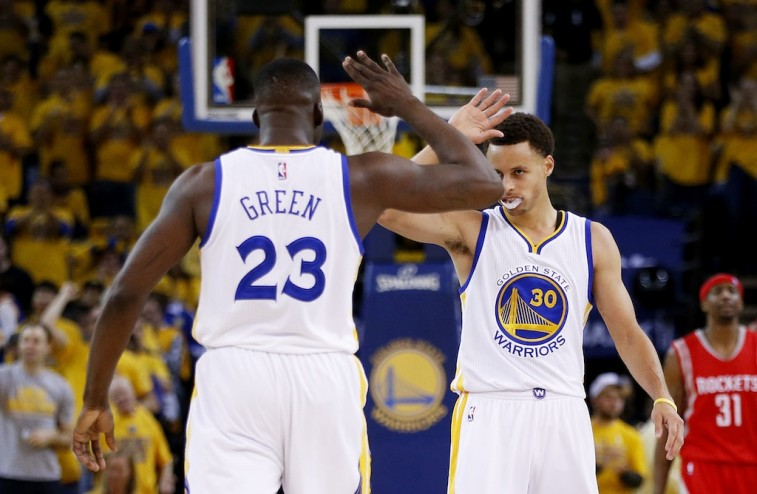Draymond Green and Stephen Curry celebrate in the Western Conference Finals
