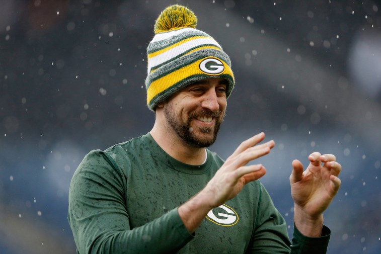 Aaron Rodgers warms up for the NFC championship game