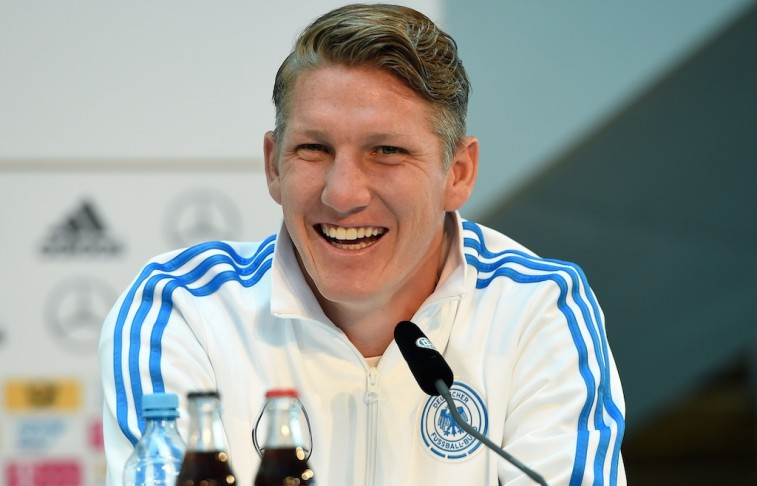 Bastian Schweinsteiger smiles during a press conference