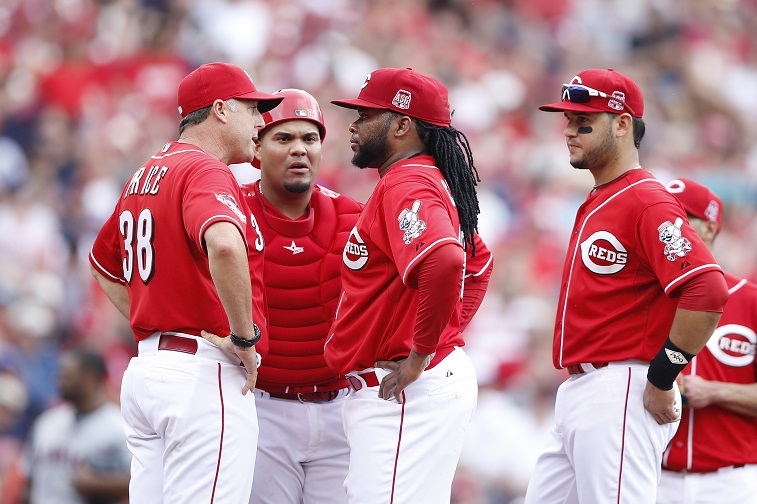 CINCINNATI, OH - JULY 19: Johnny Cueto #47 of the Cincinnati Reds listens to manager Bryan Price during a meeting at the mound in the fourth inning against the Cleveland Indians at Great American Ball Park on July 19, 2015 in Cincinnati, Ohio. (Photo by)