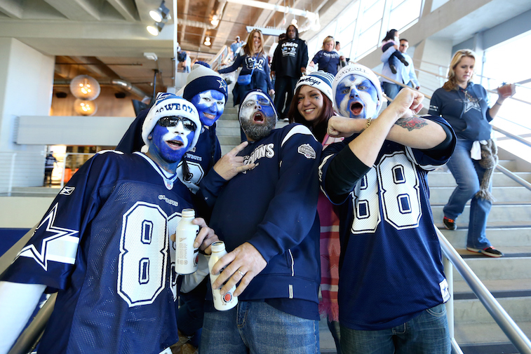 Cowboys fans pose for a picture.