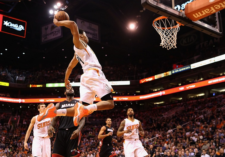 PHOENIX, AZ - FEBRUARY 11:  Gerald Green #14 of the Phoenix Suns slam dunks the ball against the Miami Heat during the second half of the NBA game at US Airways Center on February 11, 2014 in Phoenix, Arizona.  The Heat defeated the Suns 103-97. NOTE TO USER: User expressly acknowledges and agrees that, by downloading and or using this photograph, User is consenting to the terms and conditions of the Getty Images License Agreement.  (Photo by )