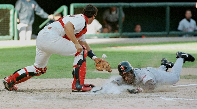 Ricky Henderson slides into home