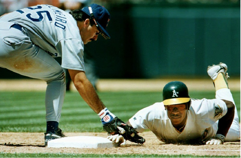 Oakland Athletics Rickey Henderson (R) goes head f