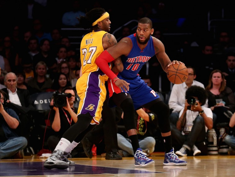 Greg Monroe backs posts up Jordan Hill