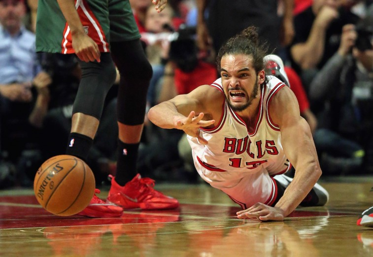 Joakim Noah dives for the ball in the 2015 NBA Playoffs