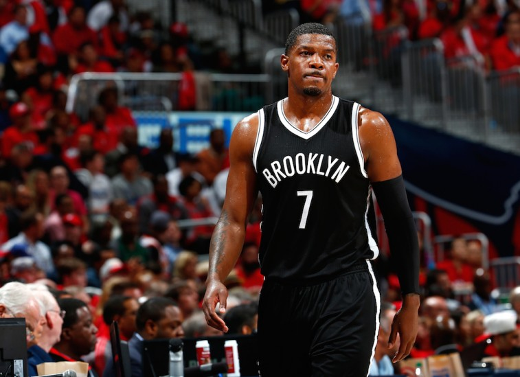 Joe Johnson looks upset as he walks across the court.