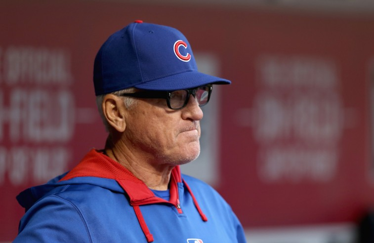 CINCINNATI, OH - APRIL 24: Joe Maddon the manager of the Chicago Cubs watches the action gainst the Cincinnati Reds at Great American Ball Park on April 24, 2015 in Cincinnati, Ohio. (Photo by Andy Lyons/Getty Images)