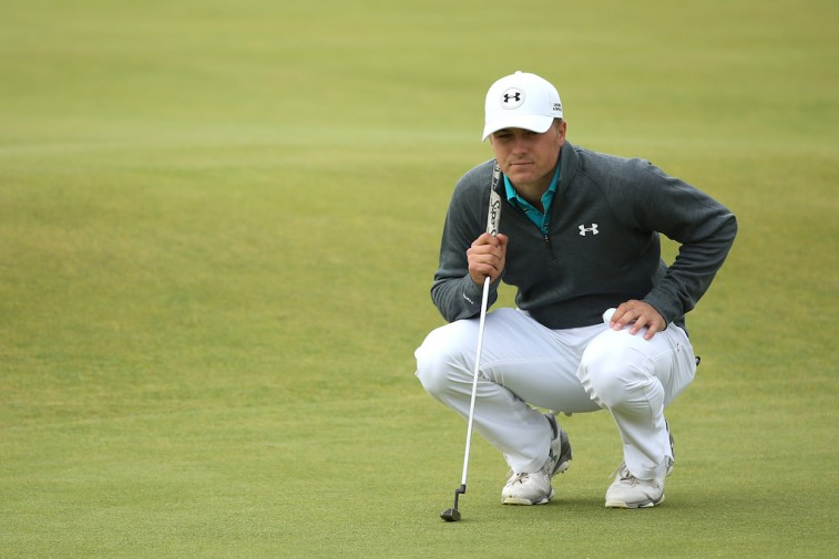 Jordan Spieth lines up a putt at The Open