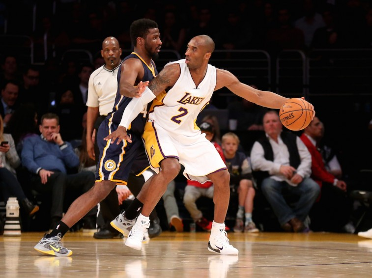 Kobe Bryant backs down Solomon Hill