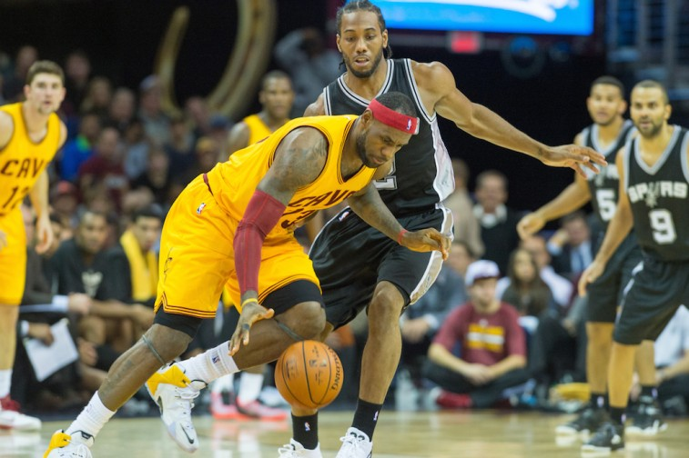 LeBron James attempts to dribble around Kawhi Leonard