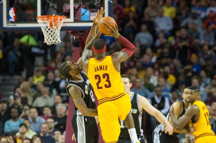 LeBron James tries to get shot off against Kawhi Leonard