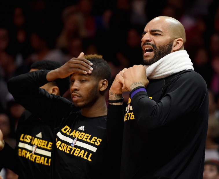 Los Angeles Lakers bench reacts to a foul