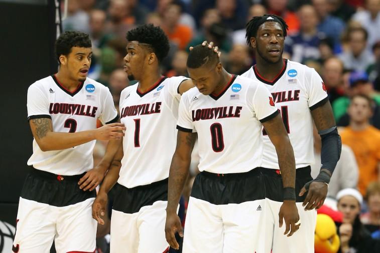 Louisville Cardinals react to basket during the NCAA Tournament