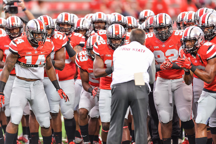 Head Coach Urban Meyer of the Ohio State Buckeyes rallies his team before a game against the Virginia Tech Hokies at Ohio Stadium on September 6, 2014 in Columbus, Ohio.  (Photo by Jamie Sabau/Getty Images)
