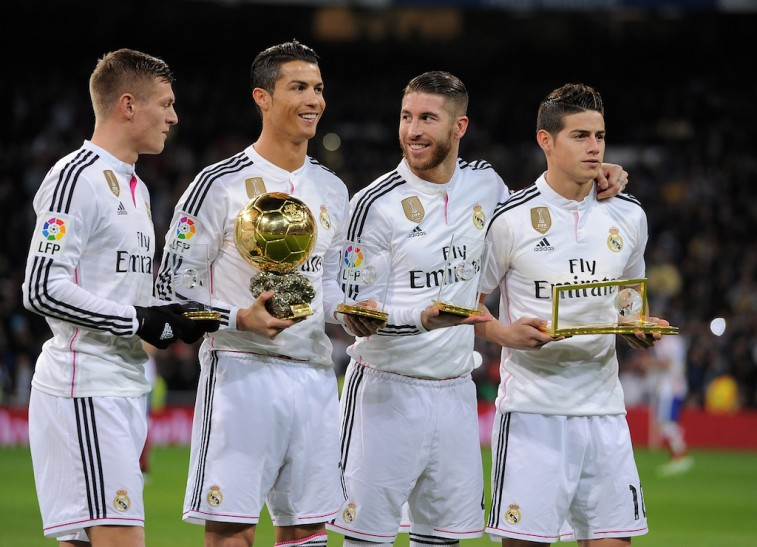 Real Madrid smiles with their trophies.