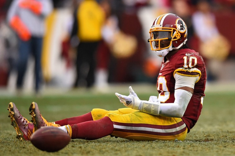 Robert Griffin III reacts after throwing interception against the Cowboys