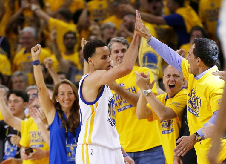 Stephen Curry celebrates with the fans at Oracle Arena