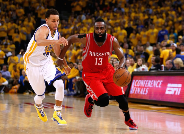 James Harden attempts to dribble by Stephen Curry in the Western Conference Finals