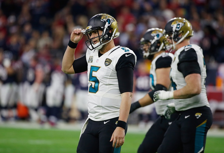 Blake Bortles #5 of the Jacksonville Jaguars looks to pass during their game against the Houston Texans at NRG Stadium on December 28, 2014 in Houston, Texas.