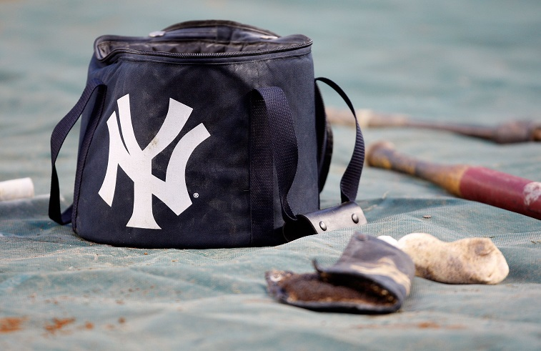 New York Yankees gear sitting out on the field.