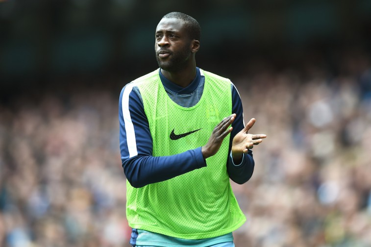 Yaya Toure warms up before a match with his team, Manchester City