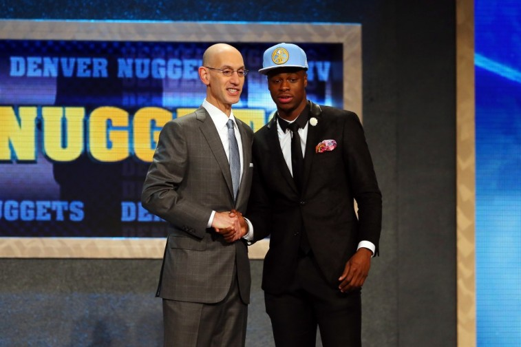 Emmanuel Mudiay shakes Adam Silver's hand after being selected by the Nuggets during the 2015 NBA Draft