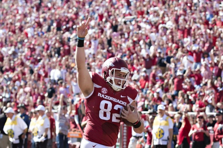 Luke Rossi scores a touchdown for Arkansas
