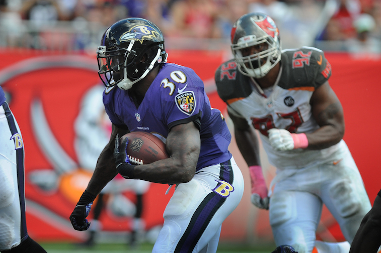 Bernard Pierce runs against the Tampa Bay Bucs