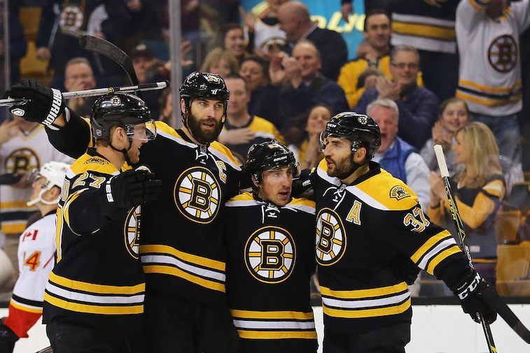 The Boston Bruins celebrate a goal