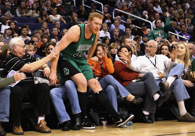 Brian Scalabrine falls into the crowd in a game against the Suns