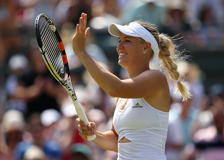 Caroline Wozniacki waves to crowd after winning match at Wimbledon