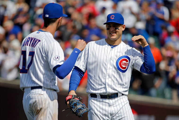 Kris Bryant and Anthony Rizzo (R) celebrate a Cubs win