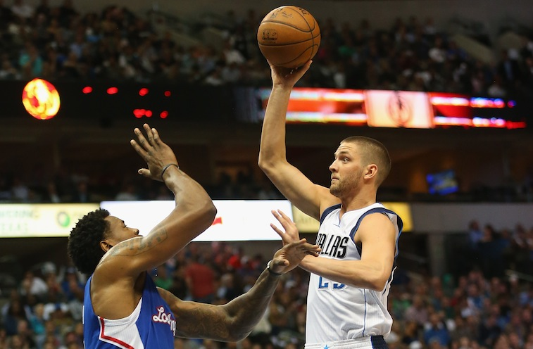 DALLAS, TX - FEBRUARY 09: Chandler Parsons #25 of the Dallas Mavericks takes a shot against DeAndre Jordan #6 of the Los Angeles Clippers at American Airlines Center on February 9, 2015 in Dallas, Texas. NOTE TO USER: User expressly acknowledges and agrees that, by downloading and or using this photograph, User is consenting to the terms and conditions of the Getty Images License Agreement. (Photo by Ronald Martinez/Getty Images)