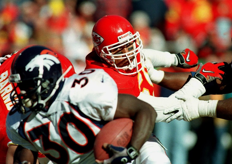 KANSAS CITY, : In this 16 November 1997 file photo, Kansas City Chiefs linebacker Derrick Thomas (C) is shown pursuing Denver Broncos running back Terrell Davis during their 16 November1997 game in Kansas City, Missouri. Thomas died of cardiac arrest 08 February 2000 at Jackson Memorial Hospital in Miami, Florida where he was hospitalized for rehabilitation therapy after breaking his neck and spine in an automobile accident in Kansas City January 23, 2000. He was 33.
